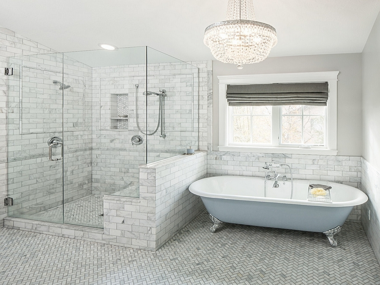 Freestanding slipper bathtubs gray and blue bathroom